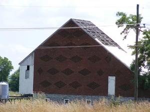 From the highway, the handsomely decorative brick Swisser barn circa 1895 – the old farmstead is crumbling from demolition by neglect. Vilified as a 'security issue,' and maligned as 'an impediment to eligible airport development,' this farm is owned by the government and citizens of Washington County.